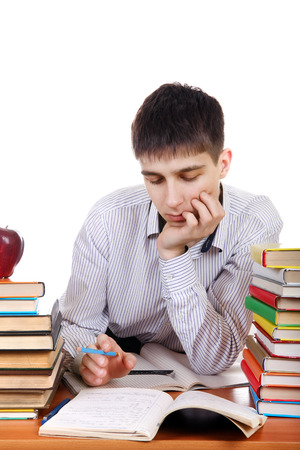 wearied: Tired Student at the School Desk Isolated on the White Background Stock Photo