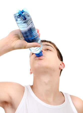 gladden: Teenager drinking the Pure Water on the White Background
