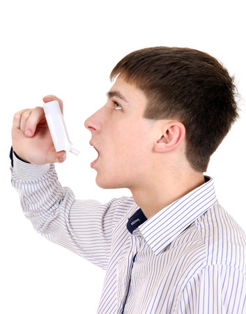 Teenager using Inhaler Isolated on the White Background Stock Photo - 27215077
