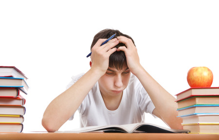 wearied: Tired and Troubled Student at the Writing Table Isolated on the White Background