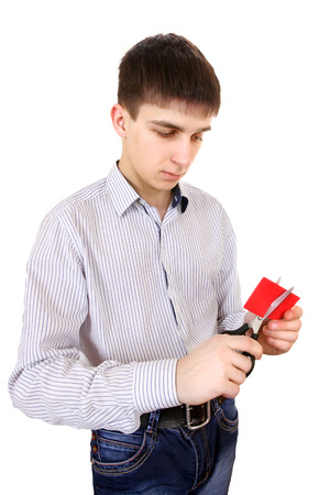 Teenager cutting a Credit Card Isolated on the White Background photo