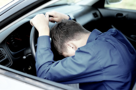 Young Man fall asleep in a Car photo