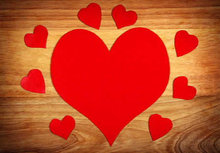 Heart Shapes on Wooden Board for St. Valentines Day photo