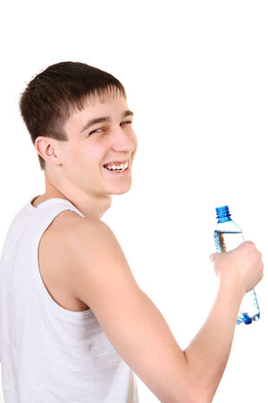 Happy Teenager with Bottle of Water on the White Background photo