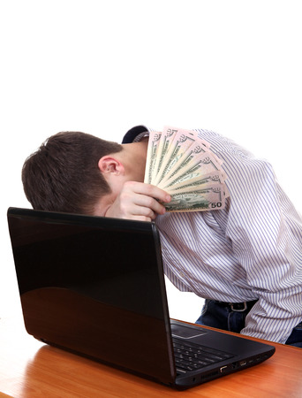 Sad Teenager with Laptop and Money Isolated on the White Background photo
