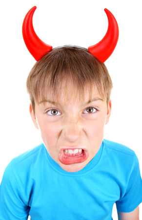 depraved: Angry and Naughty Kid with Devil Horns on the Head Isolated on the White Background Stock Photo