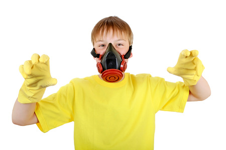 Kid in Gas Mask and Rubber Gloves Isolated on the White Background photo