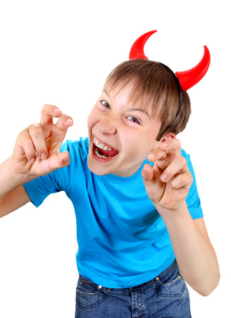 insidious: Sly Kid with Devil Horns on the Head Isolated on the White Background
