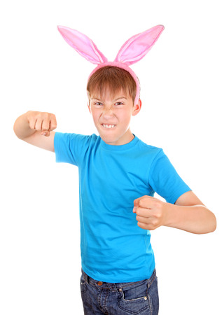 angriness: Kid with Bunny Ears threaten with a Fist Isolated on the White Background