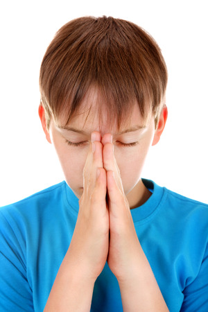 supplicate: Kid praying Isolated on the White Background