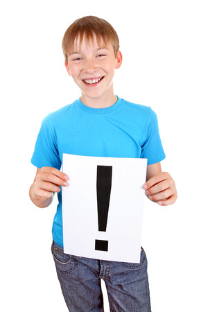 noteboard: Cheerful Kid holds a sheet with Exclamation Mark Isolated on the White Background Stock Photo