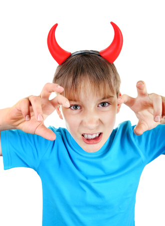 derision: Sly Kid with Devil Horns on the Head Isolated on the White Background