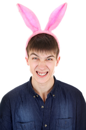 angriness: Angry Teenager with Bunny Ears Isolated on the White Background