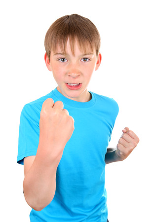 Angry Kid threaten with a Fist Isolated on the White Background Stock Photo