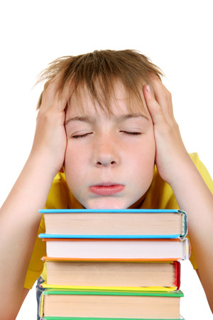 Tired Kid with the Books Isolated on the White Background photo