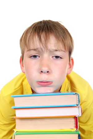 tedium: Tired Kid with the Books Isolated on the White Background Stock Photo