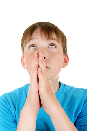 supplicate: Focus on the Hands. Kid praying Isolated on the White Background