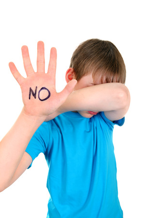 Sad Kid shows the palm gesture with an inscription NO. Focus on the Palm Stock Photo