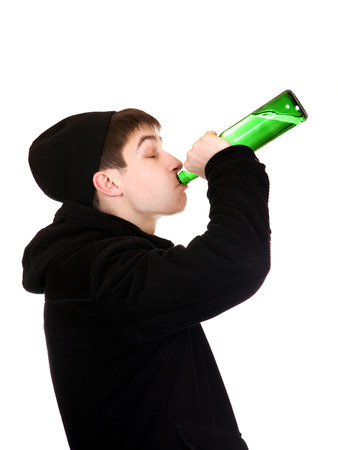 Teenager drinks a Beer on the White Background photo