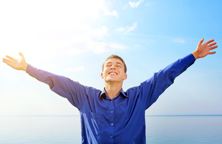 happy teens: Happy Teenager with Hands Up on the Sea background