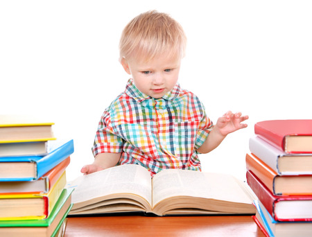 Baby Boy with the Books at the Desk Isolated on the White Background