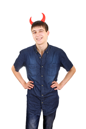 insidious: Sly Teenager with Devil Horns on the Head Isolated on the White Background Stock Photo