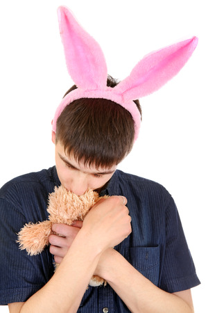 sissy: Infantile Teenager with Bunny Ears and Teddy Bear Isolated on the White Background