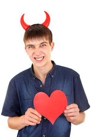 angriness: Angry Teenager with Devil Horns and Red Heart Shape Isolated on the White Background