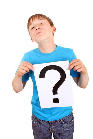 ques: Kid holding a Paper with Question Mark on the White Background