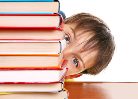 boyhood: Surprised Kid behind the Books Isolated on the White Background Stock Photo