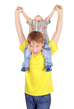 Happy Kid and Baby Boy sitting on the Shoulders on the White Background photo