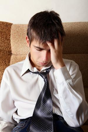 sorrowful: Sorrowful Teenager on the Sofa at the Home