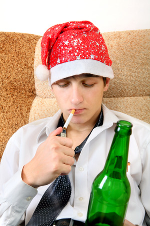 necktie beer: Teenager in Santa Hat with Bottle of the Beer smoking Cigarette
