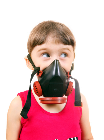 Little Girl in in Gas Mask Isolated on the White Background photo