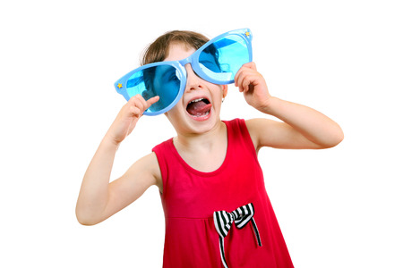 Cheerful Little Girl with Big Blue Glasses Isolated on the White Background photo