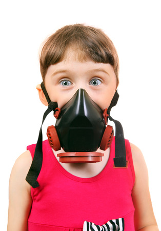 Surprised Little Girl in in Gas Mask Isolated on the White Background photo