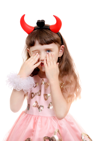 depraved: Sad Little Girl with Devil Horns on the White Background