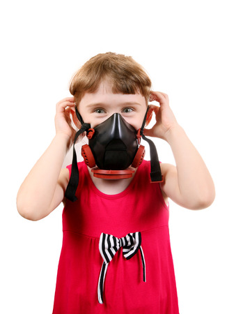 Cheerful Little Girl in in Gas Mask Isolated on the White Background photo