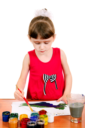 Concentrated Little Girl Drawing Isolated on the white background photo