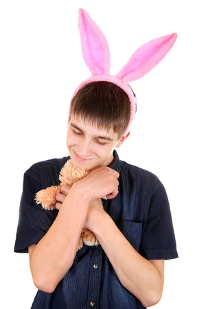sissy: Teenager with Bunny Ears and Teddy Bear Isolated on the White Background