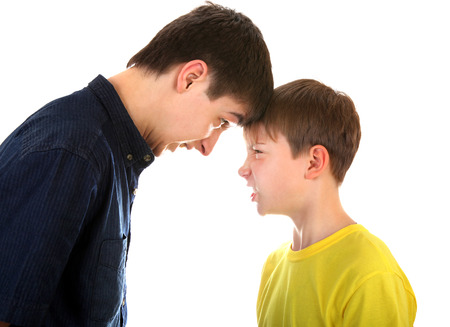 dissension: Angry Teenager and Kid looking to each other on the White Background