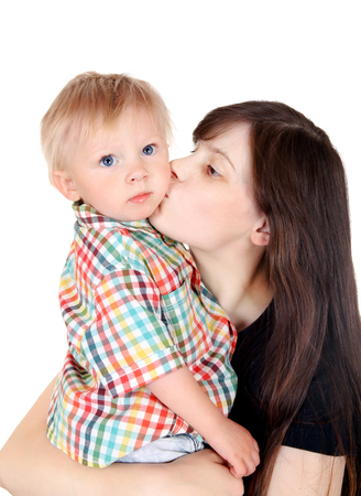 Young Mother kiss a Child Isolated on the White Background photo