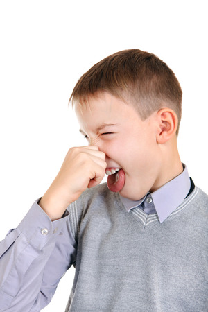 nose plugs: Displeased Kid Close the Nose Isolated on the White Background