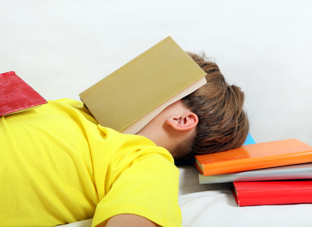 the weariness: Tired Teenager sleep on the Books Stock Photo
