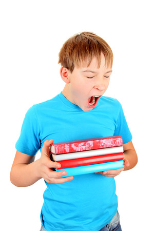 wearied: Schoolboy with the Books Yawning Isolated on the White Background