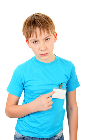 Sad Kid pointing on the Badge on t-shirt Isolated on the White Background