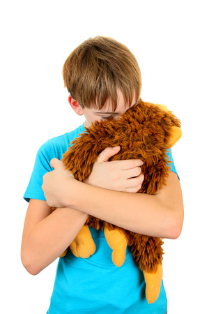 sissy: Sad Kid with Plush Toy on the White Background