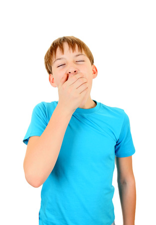 wearied: Kid Yawning Isolated on the White Background