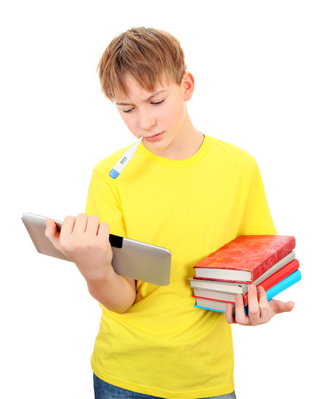 Sad and Sick Schoolboy with the Books and Tablet on the White Background photo