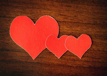 Heart Shapes on the Wooden Background photo